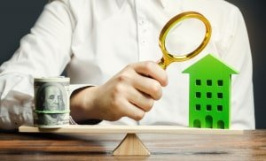 A real estate appraiser estimates the cost of housing